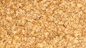 Close up porridge oats background texture. Diet healthy nutrition. Stock Images