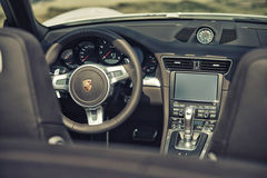 Close up on Porsche 911 carrera s car steering wheel and cockpit Stock Photo