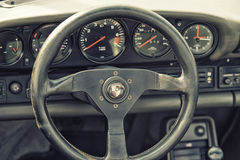 Close up on Porshe  vintage car steering wheel and cockpit. Sleza, Poland, August 15, 2015: Close up on Porshe  vintage car steering wheel and cockpit on Royalty Free Stock Photography
