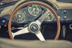 Close up on Porshe  vintage car steering wheel and kockpit Stock Photo