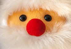 Close-up portait of Santa Claus with red nose. Close-up portait of Santa Claus ragdoll with red nose Royalty Free Stock Photography