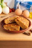 Close-up of portions of homemade Spanish potato omelette with natural ingredients. Fresh eggs, olive oil, potatoes, onion, chorizo stock photo