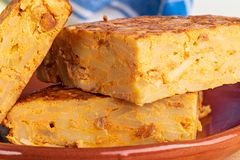 Close-up of portions of homemade Spanish potato omelette with natural ingredients. Fresh eggs, olive oil, potatoes, onion, chorizo royalty free stock image