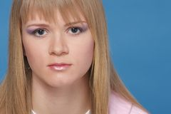 Close-up Portrait. Of young sexy blond woman on blue Stock Images