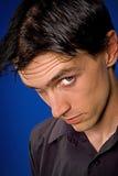 Close up portrait. Man close up portrait over blue background Stock Photos