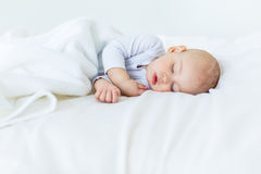 Close-up portrait of adorable baby boy sleeping in bed Stock Photography