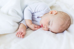Close-up portrait of adorable baby boy sleeping in bed Royalty Free Stock Photo