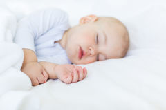 Close-up portrait of adorable baby boy sleeping in bed Royalty Free Stock Photos