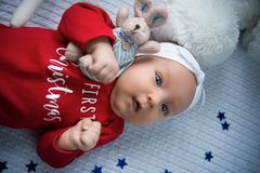 Close-up portrait of adorable little baby lying on the bed stock photography