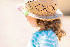 Close-up portrait of adorable little girl at the tropical resort, sunny summer day stock image