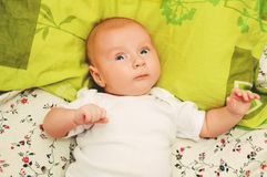 Little baby portrait. Close up portrait of adorable 4-5 month old baby lying on a pillow stock images