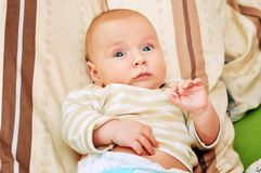 4-5 month baby. Close up portrait of adorable 4-5 month old baby lying on a pillow royalty free stock photography