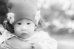 Close up portrait of adorable thai baby girl. Royalty Free Stock Photography