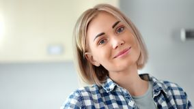 Close-up portrait of adorable young woman with natural beauty and perfect skin looking at camera. Smiling European casual tenderness blonde girl posing having stock footage