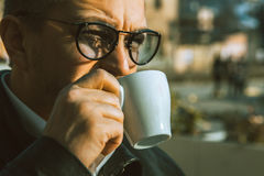 Close up portrait of adult male drinking coffee outdoors Stock Photo