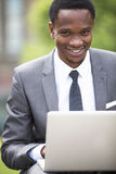 Close-up portrait of African American Businessman working on a laptop outdoors Royalty Free Stock Image