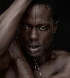 Water Dripping Down Face. Close up portrait of an African American man with water dripping down face Stock Photography