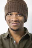 Close-up portrait of an African American man wearing knit hat Stock Photo