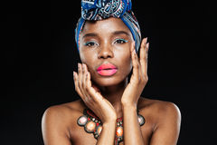 Close up portrait of an african woman posing with hands Royalty Free Stock Photos