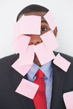 Close up portrait of Afro businessman covered in blank notes Royalty Free Stock Photography
