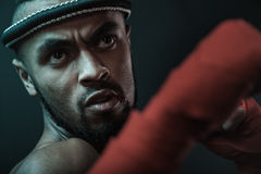 Close-up portrait of aggressive young Muay thai boxer training thai boxing. Ultimate fight concept Stock Image