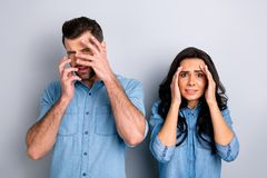 Close up portrait amazed two people she her he him his couple lady guy gesturing look oh no expression unbelievable. Unexpected wear casual jeans denim shirts stock photo