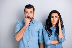 Close up portrait amazed two people she her he him his couple lady guy look oh no facial expression unbelievable. Unexpected news wear casual jeans denim shirts stock photography
