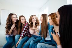 Close up portrait amazing beautiful she her diversity ladies family funny tell speak fresh unbelievable stories. Roommates sit round bright apartments girls day stock images
