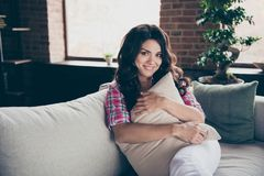 Close up portrait of amazing wonderful pretty brunette she her lady on couch comfortable leaning hugging pillows wearing royalty free stock photography