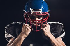 close-up portrait of angry american football player in helmet looking at camera