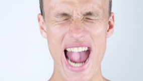 Close-up portrait of Angry ,upset ,depressesd ,young man screaming. Close-up portrait of Angry ,upset ,depressesd ,man screamingTalented Man, Creative Designer stock video footage