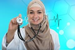 Close up portrait of arab female doctor smiling while using stethoscope Royalty Free Stock Image