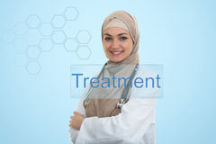 Close up portrait of arab female doctor smiling while using stethoscope royalty free stock photos