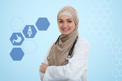 Close up portrait of arab female doctor smiling while using stethoscope Royalty Free Stock Photo