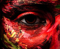 Close-up portrait of an artistic woman painted with red & green color. Stock Photos
