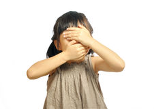 Close-up portrait of asian girl child with closed eyes and mouth Royalty Free Stock Photo