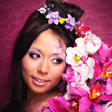 Close-up portrait of asian girl with flowers Royalty Free Stock Photos