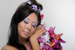 Close-up portrait of asian girl with flowers Stock Photography