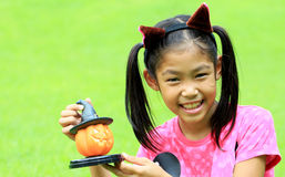 Close up portrait of Asian girl hold pumpkin doll Royalty Free Stock Images