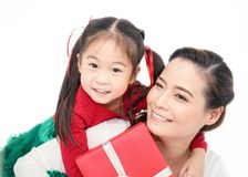 Close up portrait of Asian little toddler girl surprise her mother with gift box stock image