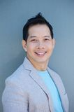 Close up portrait of an asian man smiling Royalty Free Stock Photos