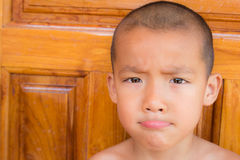 Close up portrait of a Asian young boy looking at camera. Stock Image