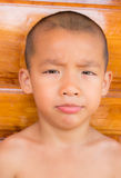 Close up portrait of a Asian young boy looking at camera. Stock Images