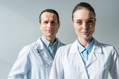 close-up portrait of attractive adult doctors looking at camera stock photo