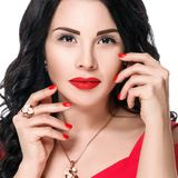 Close up portrait of attractive brunette girl with red lips and red nails. Isolated on white background Stock Photos