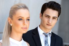 Portrait of young businessman with female colleague. Royalty Free Stock Images