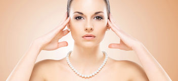 Close-up portrait of attractive caucasian girl with pearls stock photo