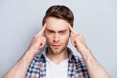Close up portrait of attractive, concentrated guy thinking abou stock images