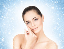 Close-up portrait of attractive and happy caucasian woman on the snow Royalty Free Stock Photos