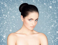 Close-up portrait of attractive and happy caucasian woman on the snow Royalty Free Stock Image